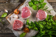 Raw filet mignon meat cuts with spice and herbs Stock Image