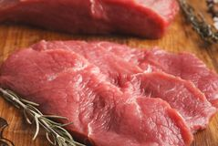 Raw beef filet mignon steaks on wooden board. Raw filet mignon steaks closeup. Fresh beef meat, rosemary on wooden board, kitchen background. Organic ingredients royalty free stock image