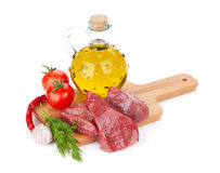 Raw fillet beef steak and spices on cutting board Stock Image