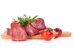 Raw fillet beef steak and spices on cutting board Royalty Free Stock Images