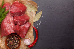 Raw fillet beef steak and spices on stone board Royalty Free Stock Photo