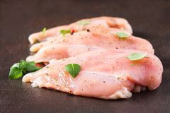 Raw fillet of chicken on rusty background. Meat ingredients for cooking. Top view. Royalty Free Stock Photography