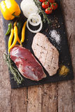 Raw fillet of duck with vegetables and spices close-up on the ch Stock Photography