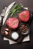 Raw fillet steak. Cooking on stone table. Top view stock photo