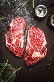 Raw  Fillet steaks for grill,BBQ or frying with herbs and spices on rustic metal background, top view Stock Images