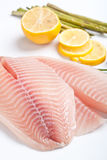 Raw filleted tilapia with asparagus Stock Photography
