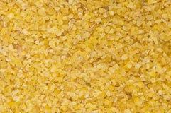 Raw fine ground burghul wheat Stock Photos