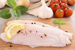 Raw fish. On board with ingredient Royalty Free Stock Image