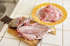 Raw fish being peel Stock Photos