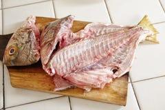 Raw fish being peel Royalty Free Stock Image