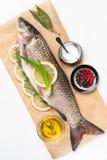 Raw fish carp prepared for roasting Stock Photo