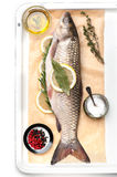 Raw fish carp with spices and herbs Royalty Free Stock Images