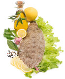 Raw fish common sole with  spices, lemon and olive oil Royalty Free Stock Photography