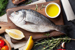 Raw fish cooking ingredients Stock Photos