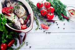 Raw fish cooking and ingredients. Royalty Free Stock Image