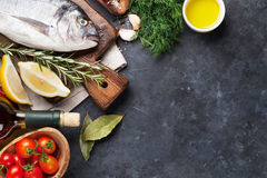 Raw fish cooking ingredients Royalty Free Stock Image