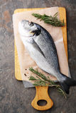 Raw fish on cutting board Royalty Free Stock Photo