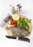 Raw fish on a cutting board. And knife Royalty Free Stock Photography
