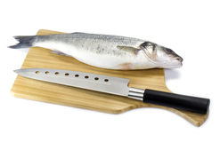 Raw fish on a cutting board. And knife Stock Photos
