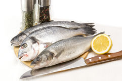 Raw fish on a cutting board. And knife Royalty Free Stock Images