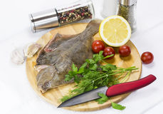 Raw fish on a cutting board. And knife Royalty Free Stock Photos