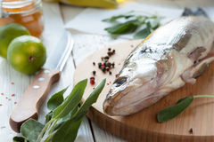 Raw fish on a cutting board, perch Stock Photo