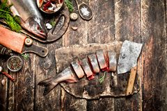 Salmon food. Raw fish. Cutting fresh salmon women's hands. On the old wooden table Royalty Free Stock Photos