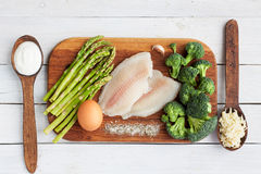 Raw fish, egg and vegetables Royalty Free Stock Image