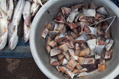 Raw fish fillet in Asian local market. Raw fish fillet in metal bucket in Asian local market Stock Images
