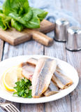 Raw fish. Fillet and lemon on the plate Stock Image