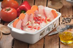 Raw fish fillet in tray to be cooked. stock photo