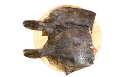 Raw fish flounder. On a white background Royalty Free Stock Photos