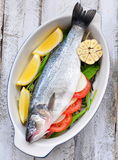 Raw fish with herbs, vegetables and garlic, selective focus Stock Photo