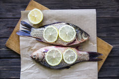 Raw fish with lemon on a cutting board Royalty Free Stock Photo