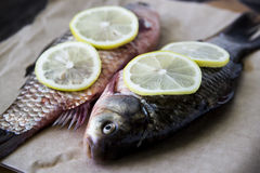 Raw fish with lemon on a cutting board Royalty Free Stock Photography