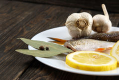 Raw fish with lemon Royalty Free Stock Images