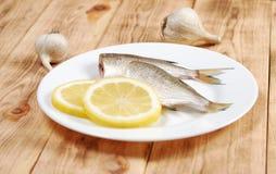 Raw fish with lemon Royalty Free Stock Image