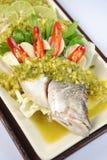 Raw fish lemon and herbs Stock Photos