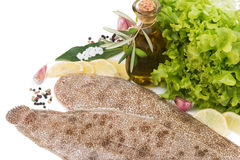 Raw fish with  lemon, olive oil and spices Stock Photo