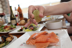 Raw fish with lime Royalty Free Stock Photos