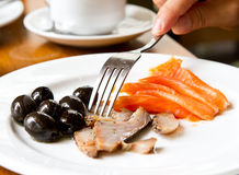 Raw fish with olives. Having a healthy meal with raw fish stock photography