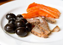 Raw fish with olives. Healthy meal with raw fish royalty free stock images