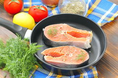 Raw fish in pan prepared for cooking. Raw fish in pan prepared for frying Stock Images