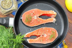 Raw fish in pan prepared for cooking. Raw fish in pan prepared for frying Royalty Free Stock Images