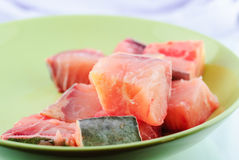 Raw fish in plate Stock Images