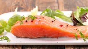 Raw fish salmon. And basil Royalty Free Stock Photos