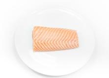 Raw fish Salmon on white dish on white background. Salmon steak Royalty Free Stock Image