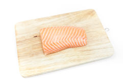 Raw fish Salmon on wooden board on white background. Salmon steak Stock Photos