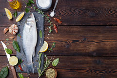 Raw fish, sea bass for cooking, grill, roasting. Raw fish, sea bass. Ingredients for cooking, grill, roasting. Top view Copy space Stock Photo