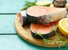 Raw fish sea bass and salmon. With lemon and herbs Stock Image